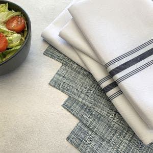 8-Piece Set. Indigo Placemats with White Bistro Napkins with Navy Blue stripes